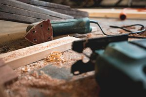 Picture of electrical tools with recently cut wood and sawdust